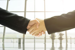 Business people handshake in office background, concept business Royalty Free Stock Photo