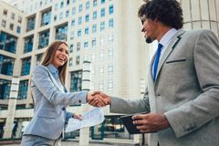 Business people handshake and smilling. Outdoor stock images