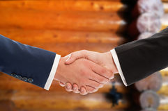 Business people handshake over wooden wall background Stock Images