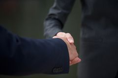 Business people handshake showing trust and teamwork. Close up business people handshake showing trust and teamwork Royalty Free Stock Image
