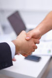 Business people handshake, sitting in the office Royalty Free Stock Photo