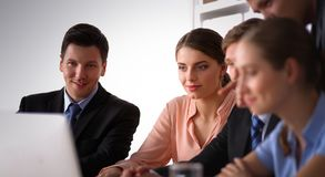 Business people handshake, sitting at the table.  Stock Photography
