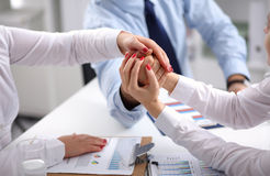 Business people handshake, sitting at the table Royalty Free Stock Photo
