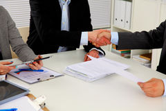Business people handshake, sitting at the table.  Royalty Free Stock Photos
