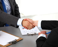 Business people handshake, sitting at the table.  Stock Images