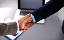 Business people handshake, sitting at the table Stock Photos