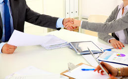 Business people handshake, sitting at the table.  Royalty Free Stock Photography