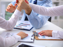 Business people handshake, sitting at the table.  Royalty Free Stock Photo