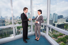 Business people handshake. To seal deal in front of city skyline Royalty Free Stock Photo
