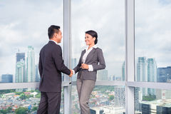 Business people handshake. To seal deal in front of city skyline Royalty Free Stock Images