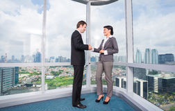 Business people handshake. To seal deal in front of city skyline Stock Photography