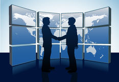 Business people handshake world map monitors Stock Photo