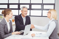 Business people handshaking with client Stock Photos