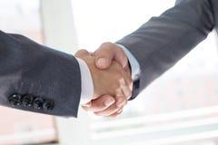 Business people handshaking Stock Photos