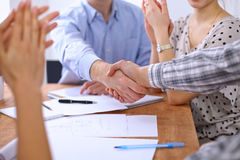 Business people handshaking finishing up meeting, close up. Royalty Free Stock Photo