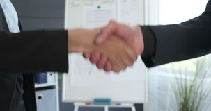 Business people handshaking at office stock video footage