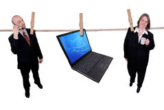 Business people hanging on a clothesline Stock Photography