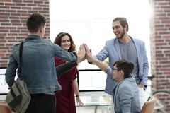 Business people happy showing team work and giving five royalty free stock photo
