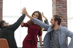 Business people happy showing team work and giving five. Concept of teamwork Royalty Free Stock Image