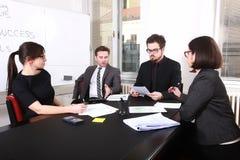 Business People Having Board Meeting Stock Image