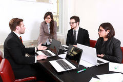 Business People Having Board Meeting Stock Photo