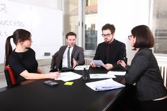 Business people having board meeting Stock Image