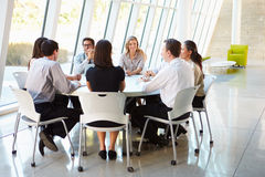 Business People Having Board Meeting In Modern Office. Discussing Stock Photos