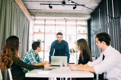 Business people having board meeting in modern office. Teamwork Stock Photo