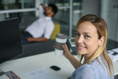 Business people having brake after job. Business people at office. Woman looking at camera Stock Image