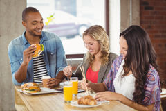 Business people having breakfast in office Royalty Free Stock Photography