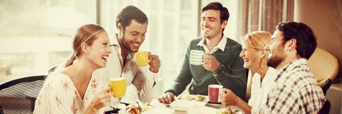 Business people having breakfast. In the office royalty free stock image