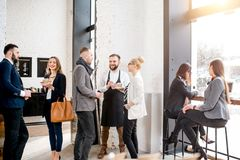 Business people in the cafe royalty free stock photography