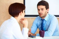Business People having conversation with colleague during break Royalty Free Stock Images