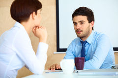 Business People having conversation with colleague during break Royalty Free Stock Photo