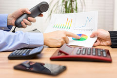Business people having a discussion about financial report nad c Stock Image