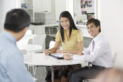 Business People Having Discussion In Meeting Room Stock Images