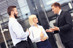 Business people having discussion outside modern building Stock Photos