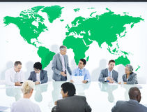 Business People Having a Discussion and World Map Stock Image