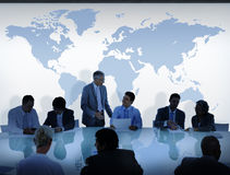 Business People Having a Discussion and World Map.  Royalty Free Stock Photography