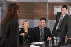 Business people having fun. On meeting, Businesswoman kidding, partners laughing Royalty Free Stock Photography