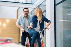 Business people having fun riding a bicycle Stock Photo