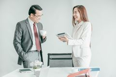 Business people having fun and talking at workplace office. Business people having fun and smile while talking at workplace office stock images