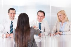 Business people having a handshake Stock Images