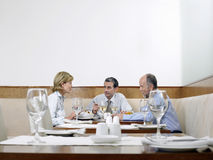 Business People Having Lunch In Restaurant Stock Photo