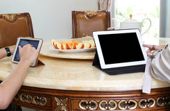 Business people having lunch and work with ipad tea and fresh fr Stock Image