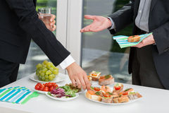 Business people having meal together Royalty Free Stock Photos