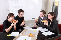 Business People Having Meal Together Royalty Free Stock Image