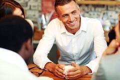 Business people having meeting around table Stock Photo