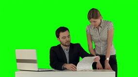 Business people Having Meeting Around Table with. Laptop on laptop on a Green Screen, Chroma Key.  Professional shot on BMCC RAW with high dynamic range. You stock video