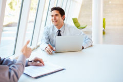 Business people Having Meeting Around Table In Modern Office. Discussing Royalty Free Stock Image